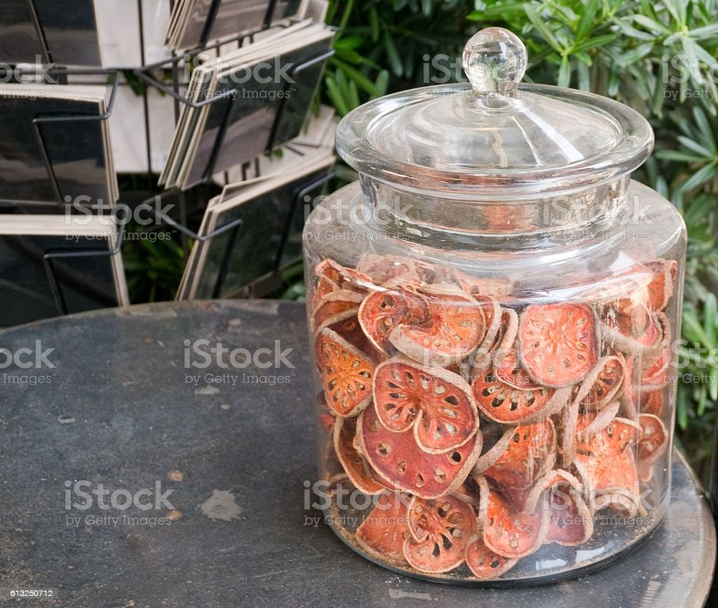 Sliced and Dried Quince in A Glass Bottle stock photo