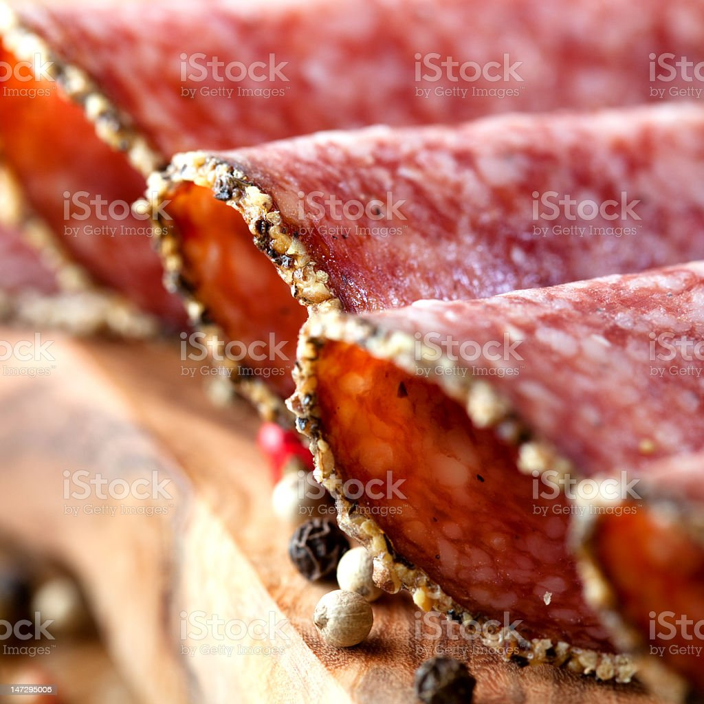 Sliced and plated pepper crusted salami royalty-free stock photo