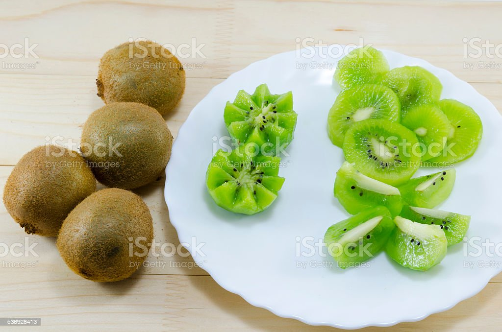Sliced and whole kiwi on a table royalty-free stock photo
