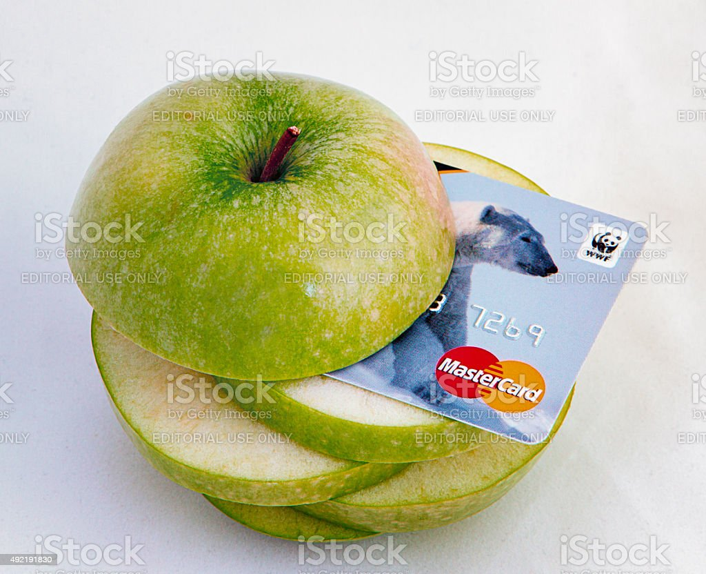 Sliced apple with Master Card stock photo