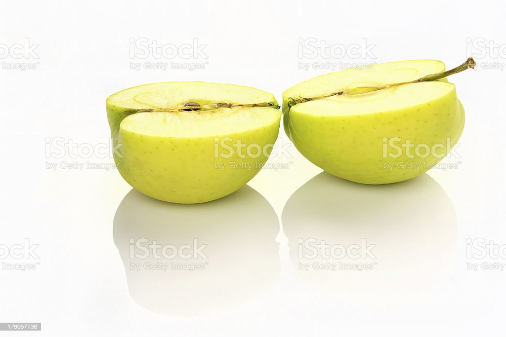 sliced apple with reflection royalty-free stock photo