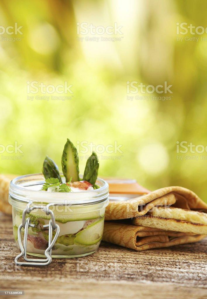 Sliced asparagus in a white bean puree sauce stock photo