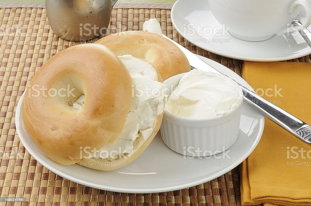 Sliced bagel with cream cheese stock photo