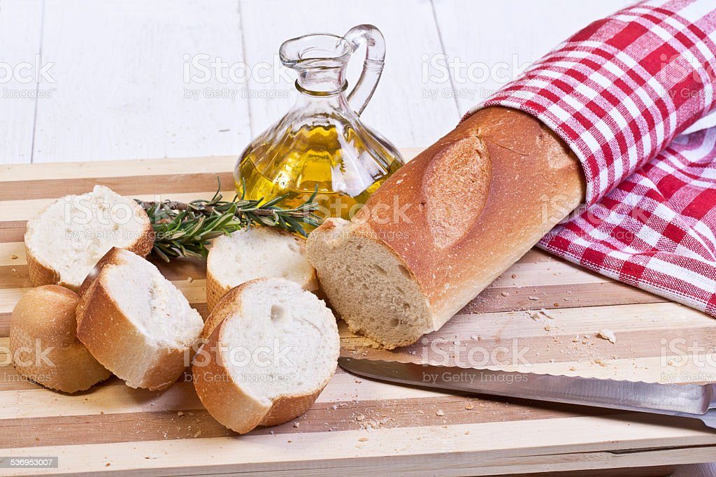 sliced baguette bread and oil stock photo