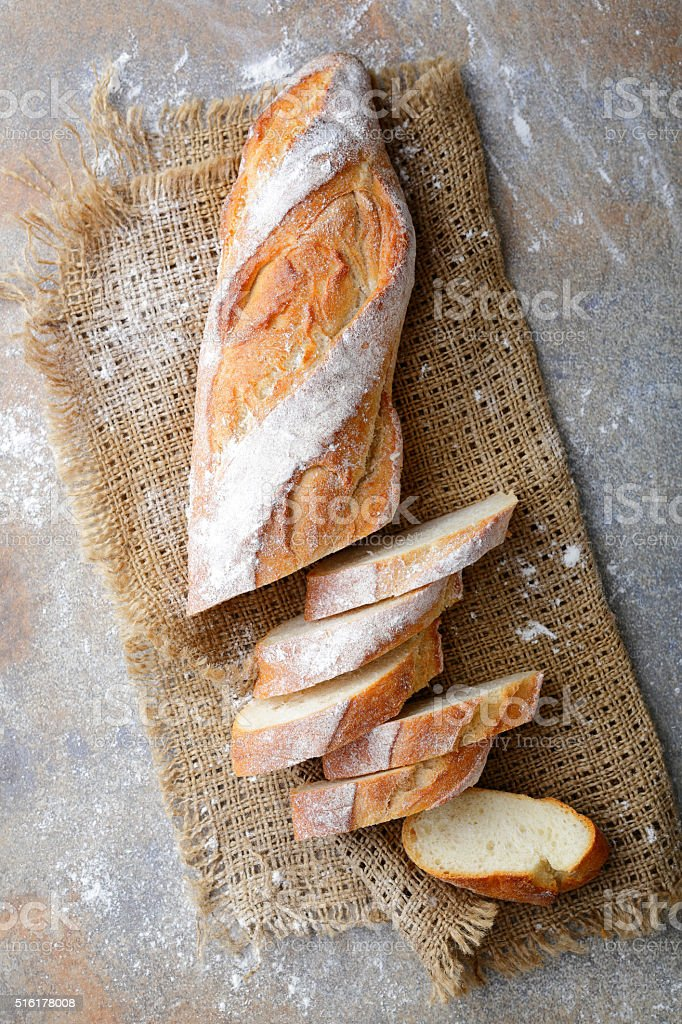 Sliced Baguette on the sackcloth stock photo