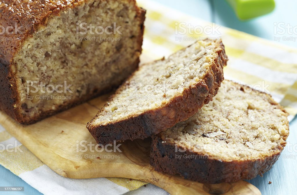Sliced banana bread on a wooden cutting board stock photo