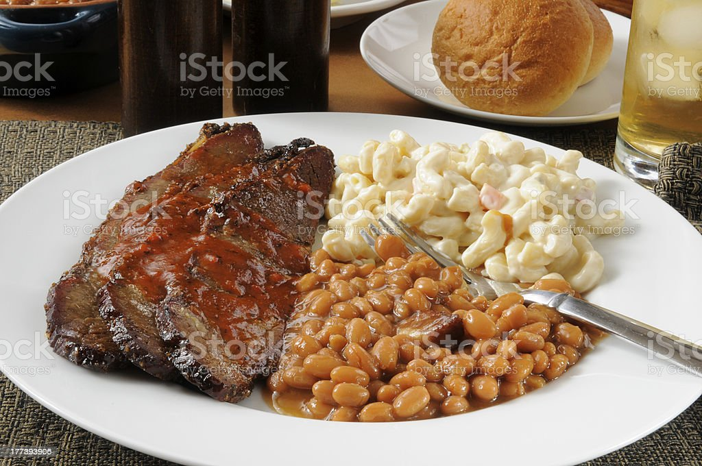 Sliced beef brisket with Boston baked beans stock photo
