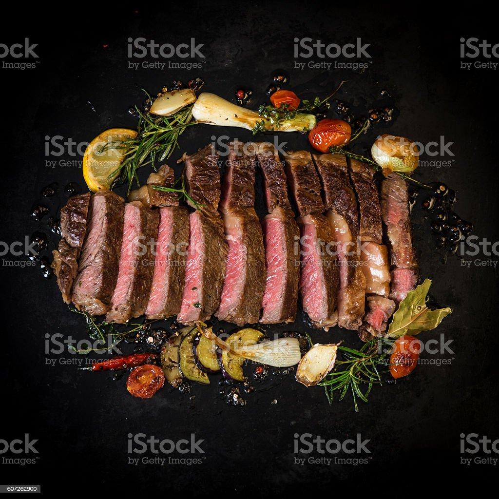 Sliced beef steak on dark background stock photo