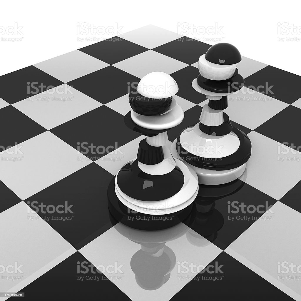 Sliced black and white pawns on chessboard royalty-free stock photo