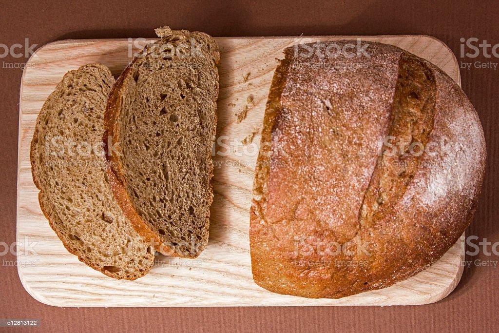 Sliced black bread on a wooden board stock photo