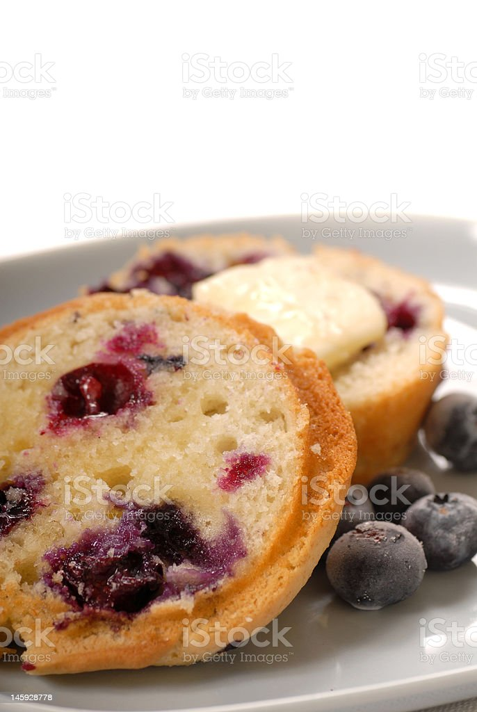 Sliced blueberry muffin with butter royalty-free stock photo