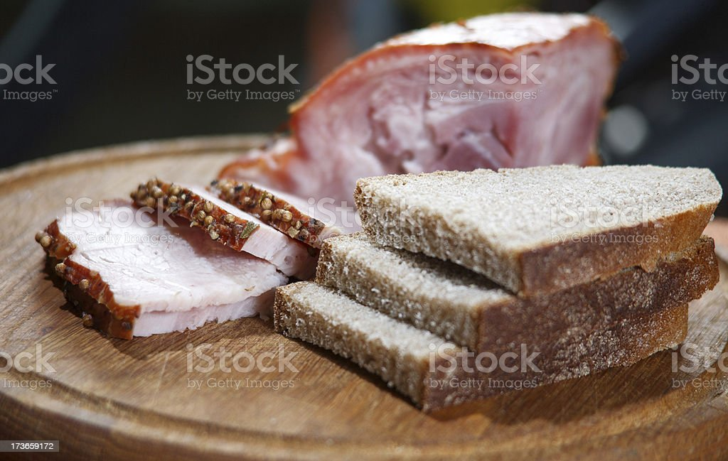 sliced €‹bread and meat on the board royalty-free stock photo