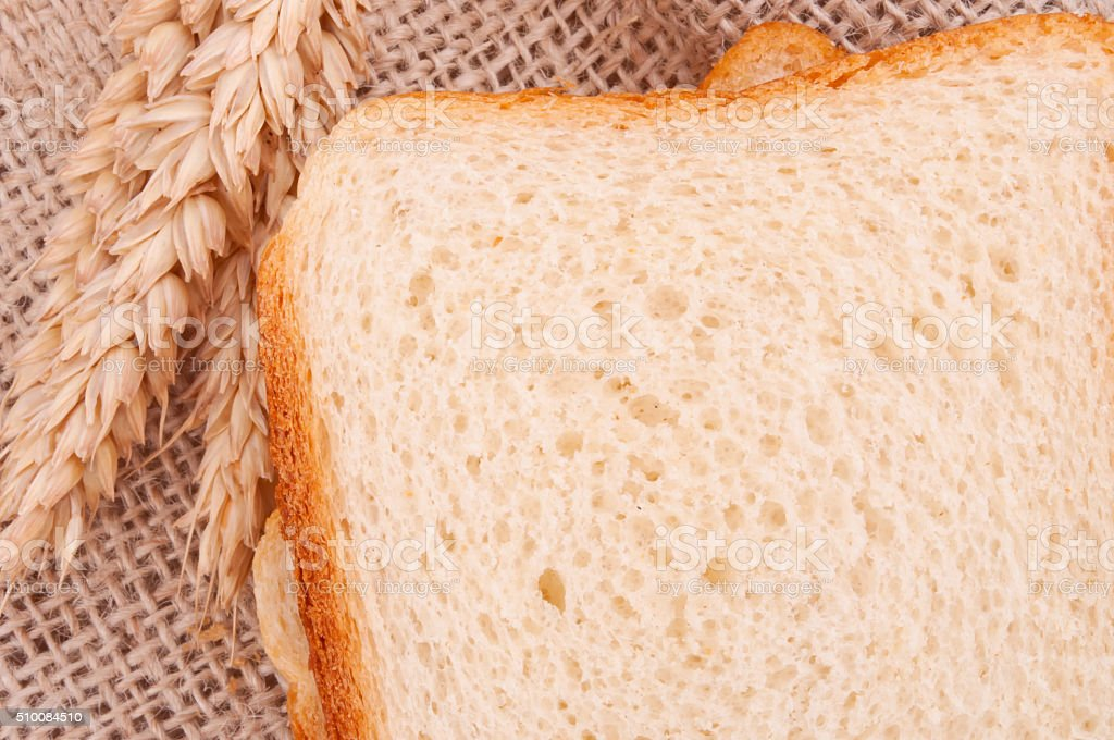 Sliced bread and wheat stock photo