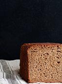 Sliced bread loaf on a black background