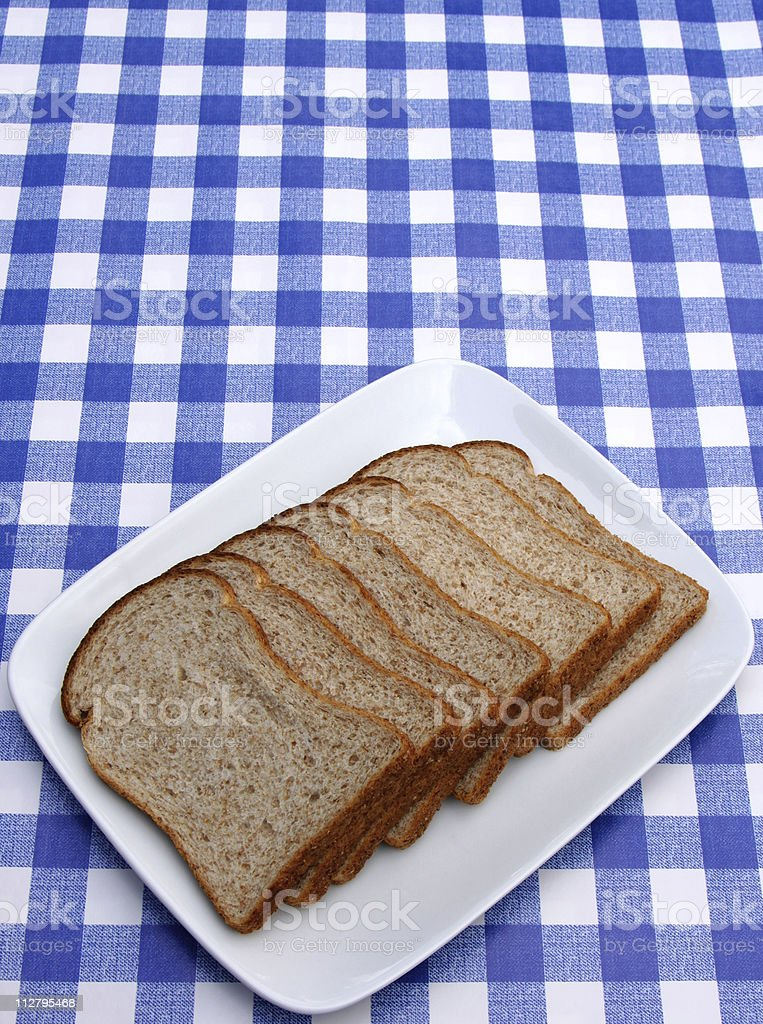 sliced bread on a serving plate stock photo