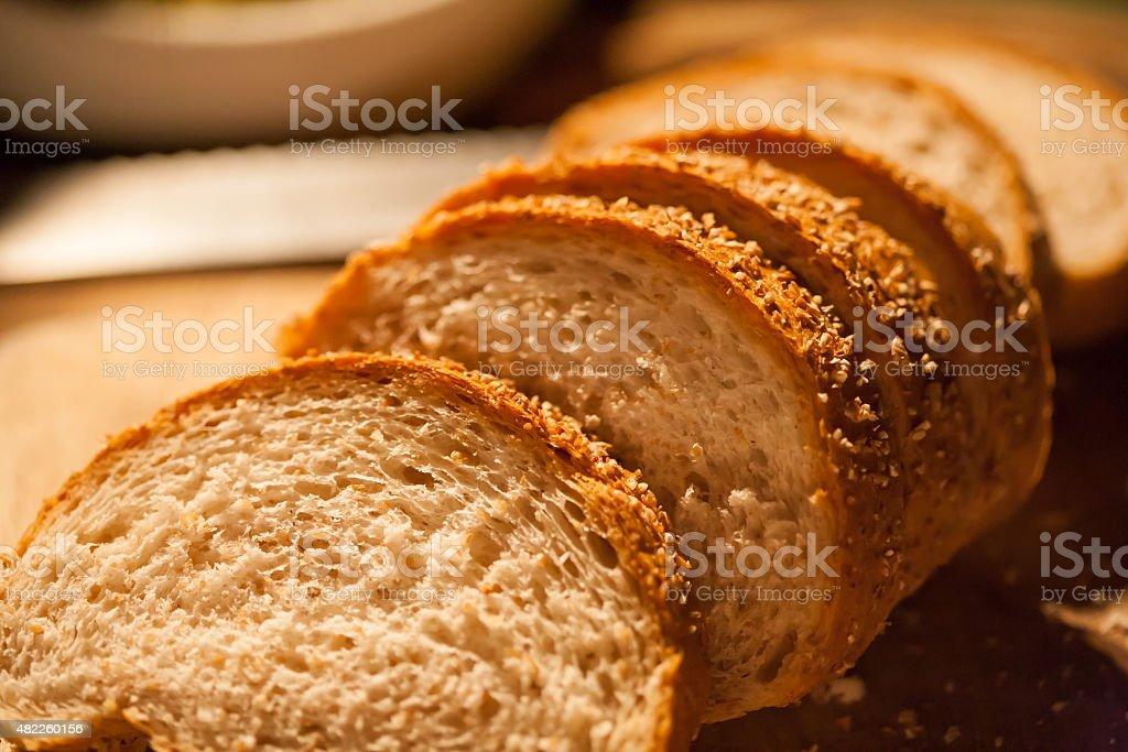 Sliced bread on cutting board closeup stock photo