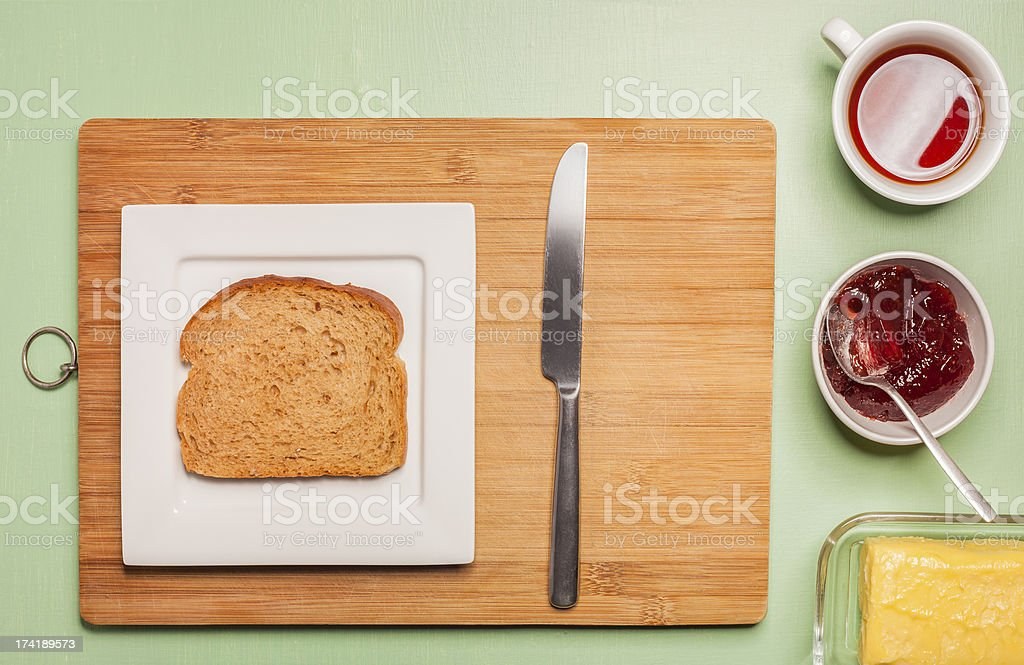 Sliced brown bread on square plate with herbal tea royalty-free stock photo