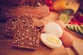 sliced brown bread with eggs close