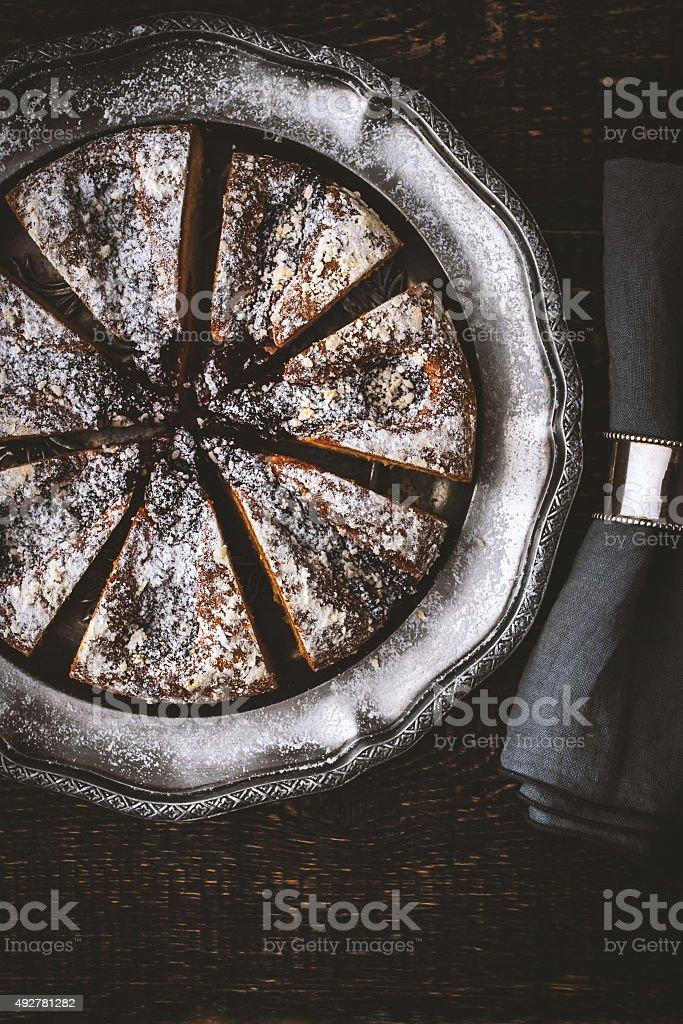 Sliced cake with powdered sugar  with napkin stock photo