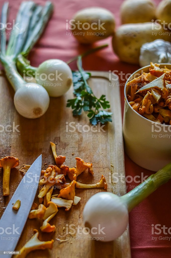 sliced chanterelle and onions with vegetables stock photo