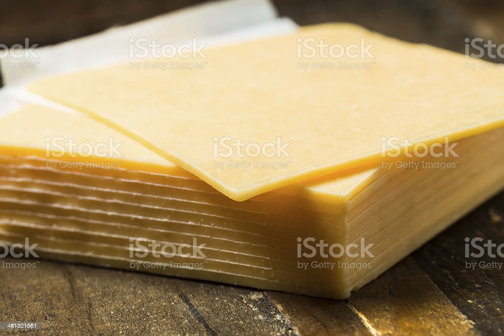 Sliced cheddar cheese stock photo