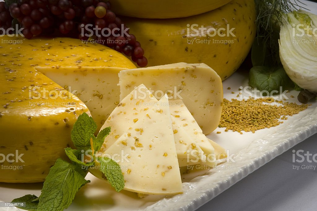 Sliced Cheese Wheel stock photo