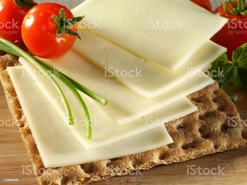 sliced cheese with tomato stock photo
