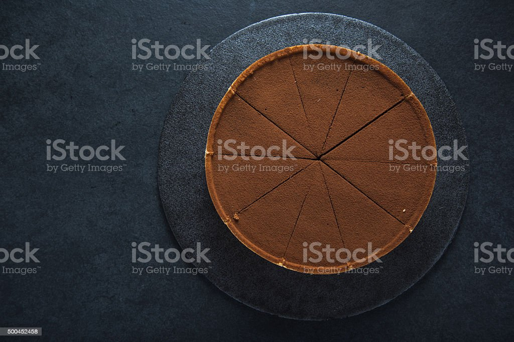 Sliced chocolate tort on dark background stock photo