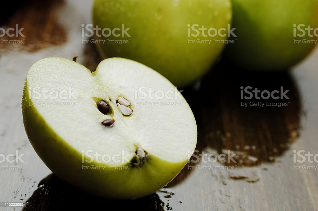 sliced crisp wet green apple royalty-free stock photo