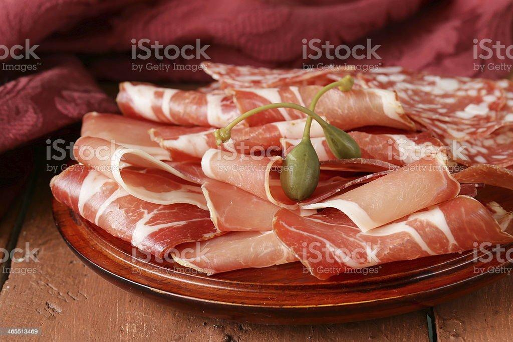 sliced dried sausage meat (ham, prosciutto, salami) stock photo
