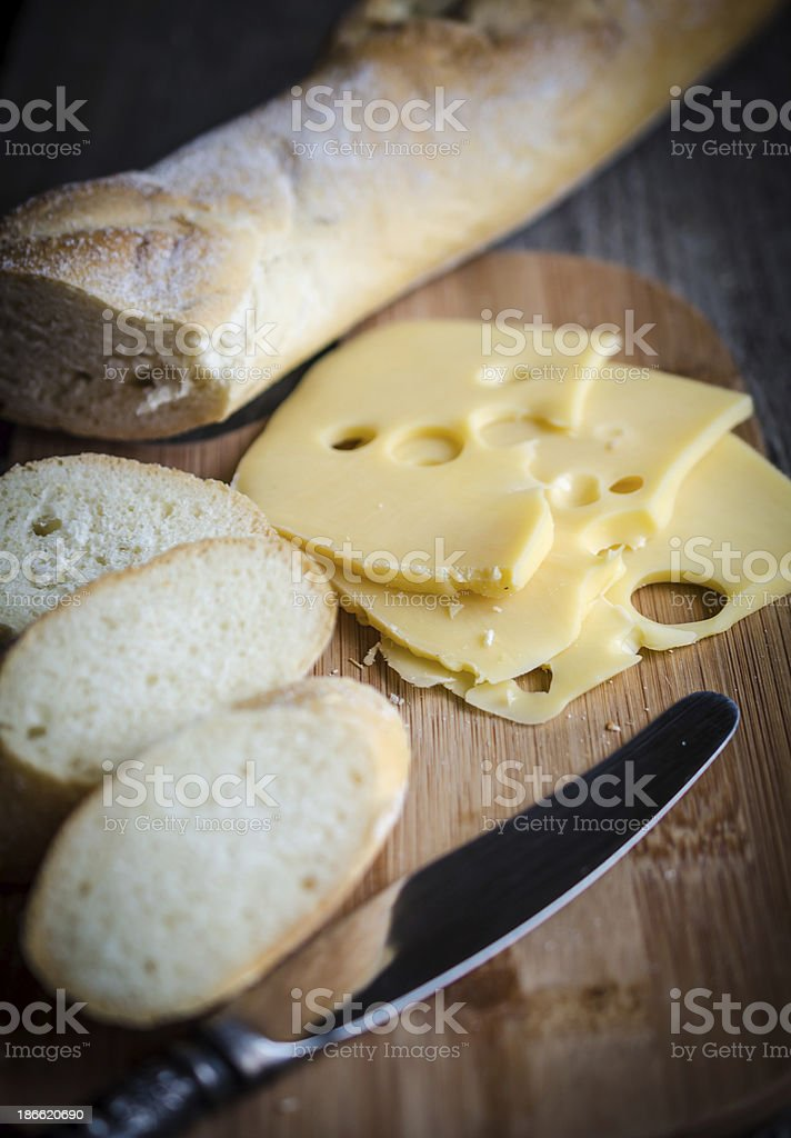 Sliced french baguette and cheese royalty-free stock photo