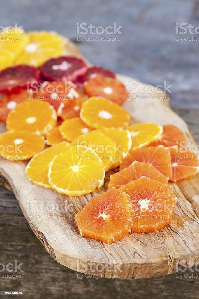 Sliced Fresh Juicy Oranges on cutting  board. royalty-free stock photo