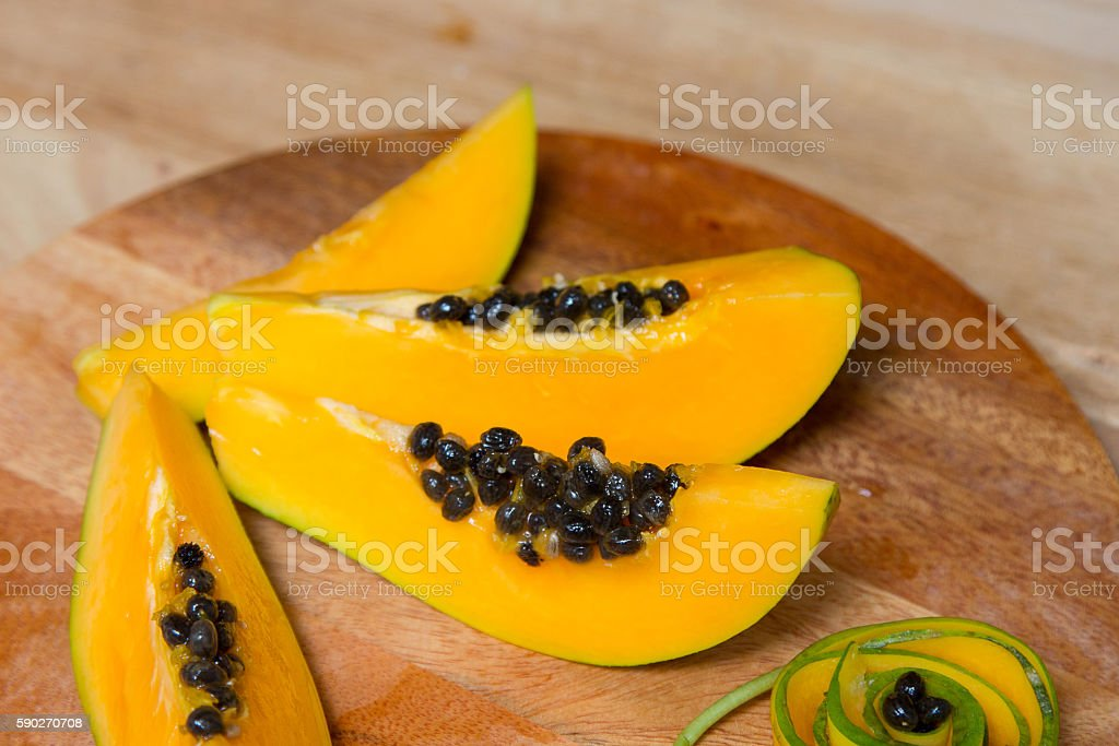 Sliced fresh papaya on wooden background. Top view stock photo