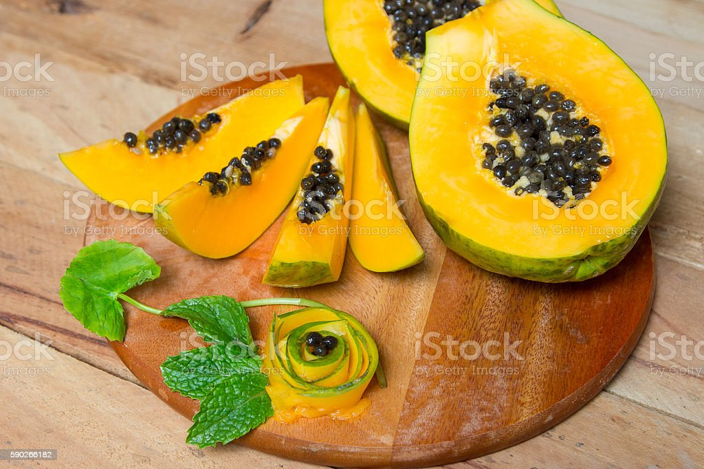 .Sliced fresh papaya. Papaya fruit on wooden background. stock photo