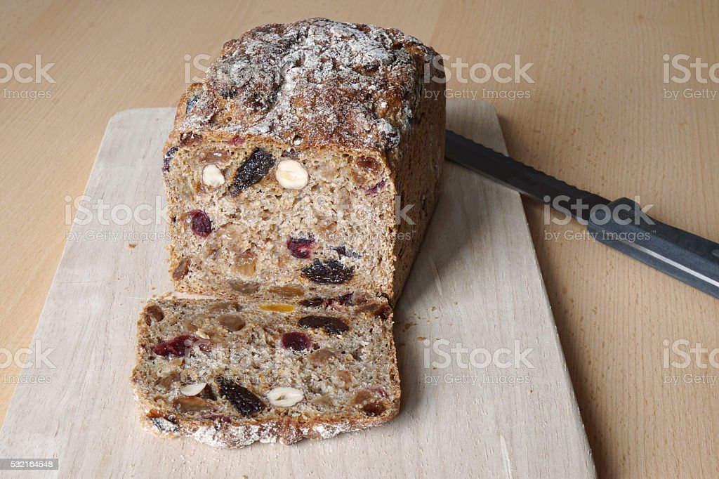 sliced fruit and nut bread stock photo