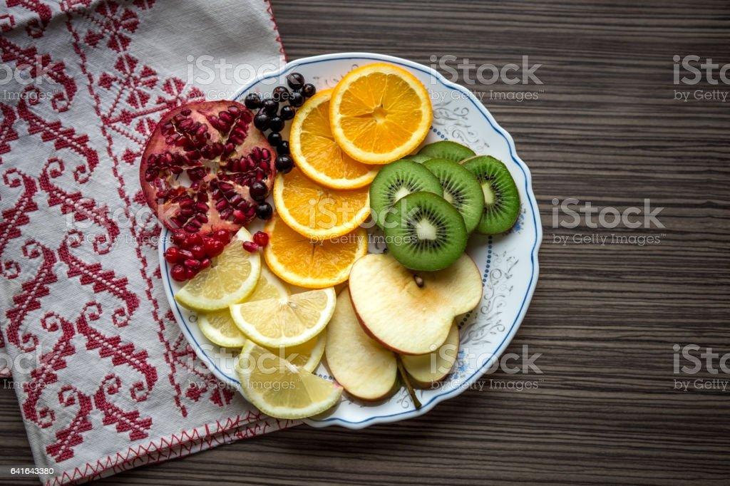 Sliced fruit: apple, pomegranate, orange, kiwi, lemons stock photo