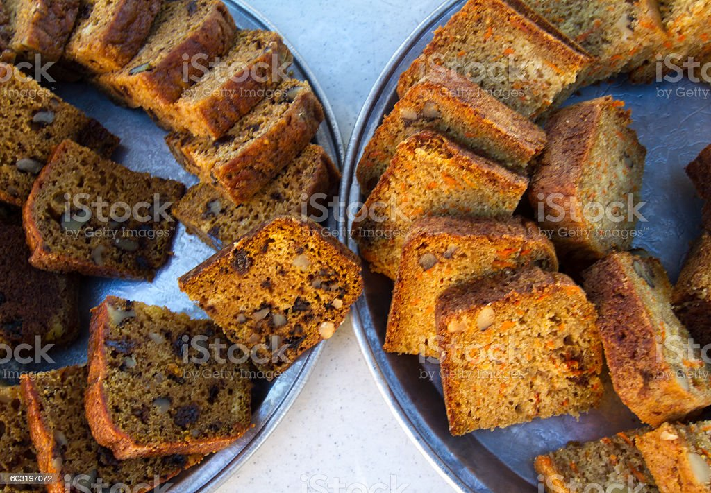 Sliced Fruit Bread/Nut Bread on Two Round Trays stock photo