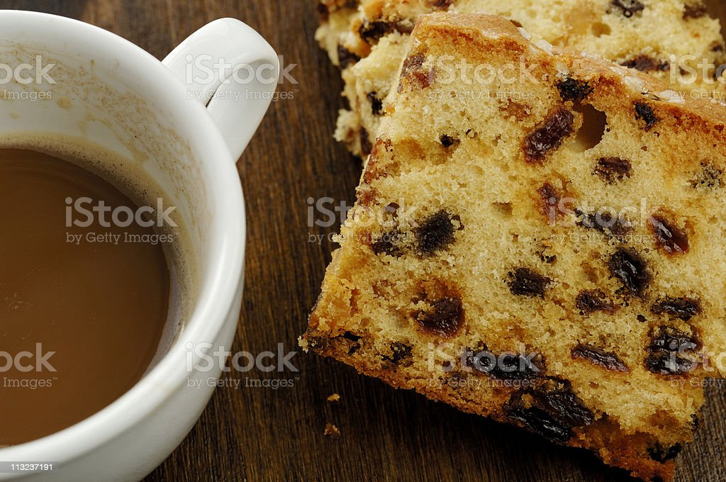 Sliced fruit cake with half drunk cup of coffee royalty-free stock photo