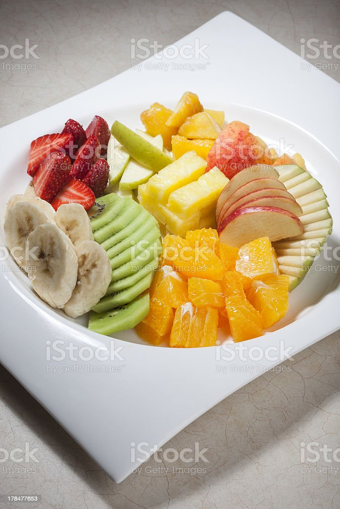 Sliced fruits on plate royalty-free stock photo