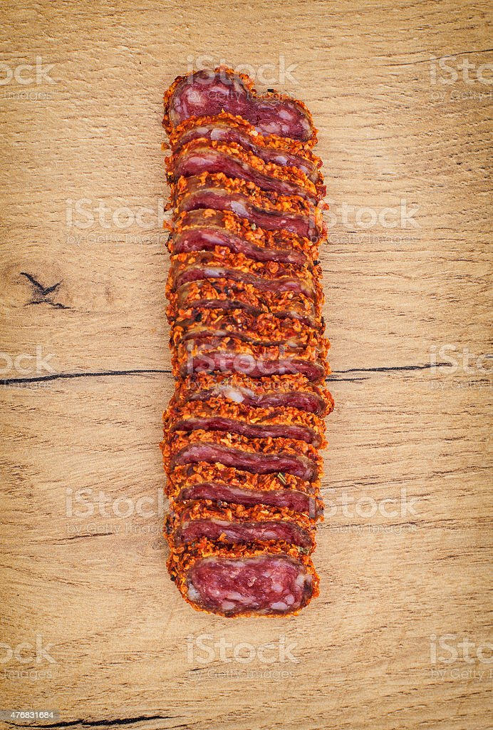 Sliced fuet with red pepper. Top view. stock photo