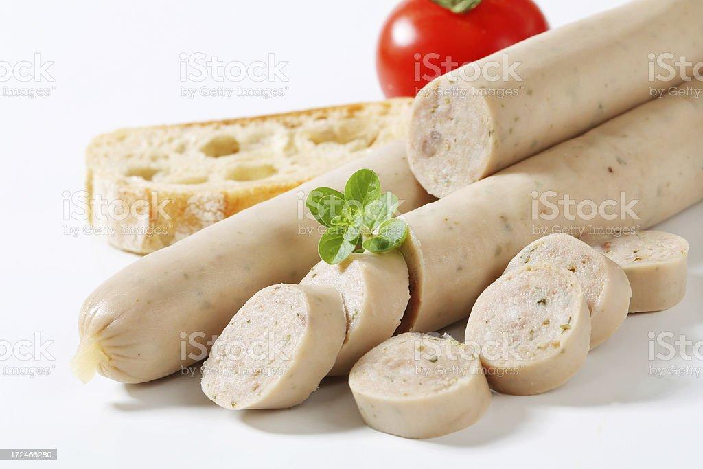 Sliced german bratwurst with white bread royalty-free stock photo