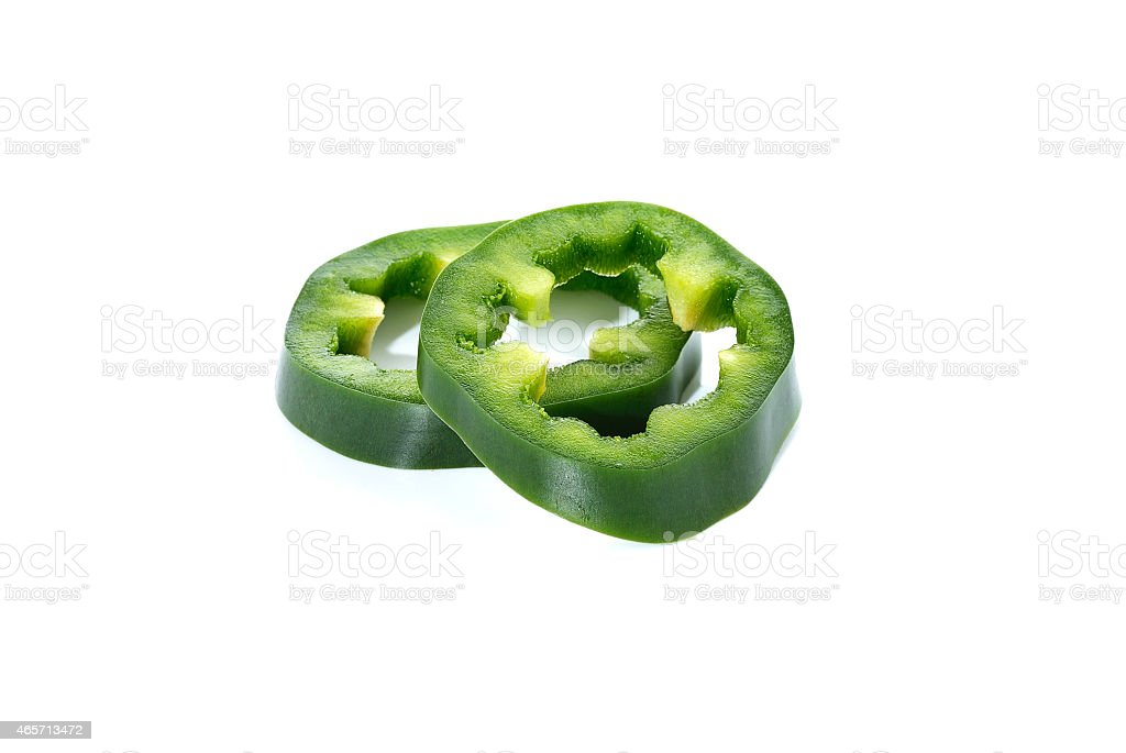 sliced green bell pepper isolated on white background stock photo