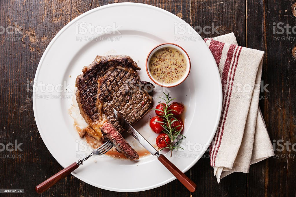 Sliced grilled steak Ribeye and Pepper sauce stock photo