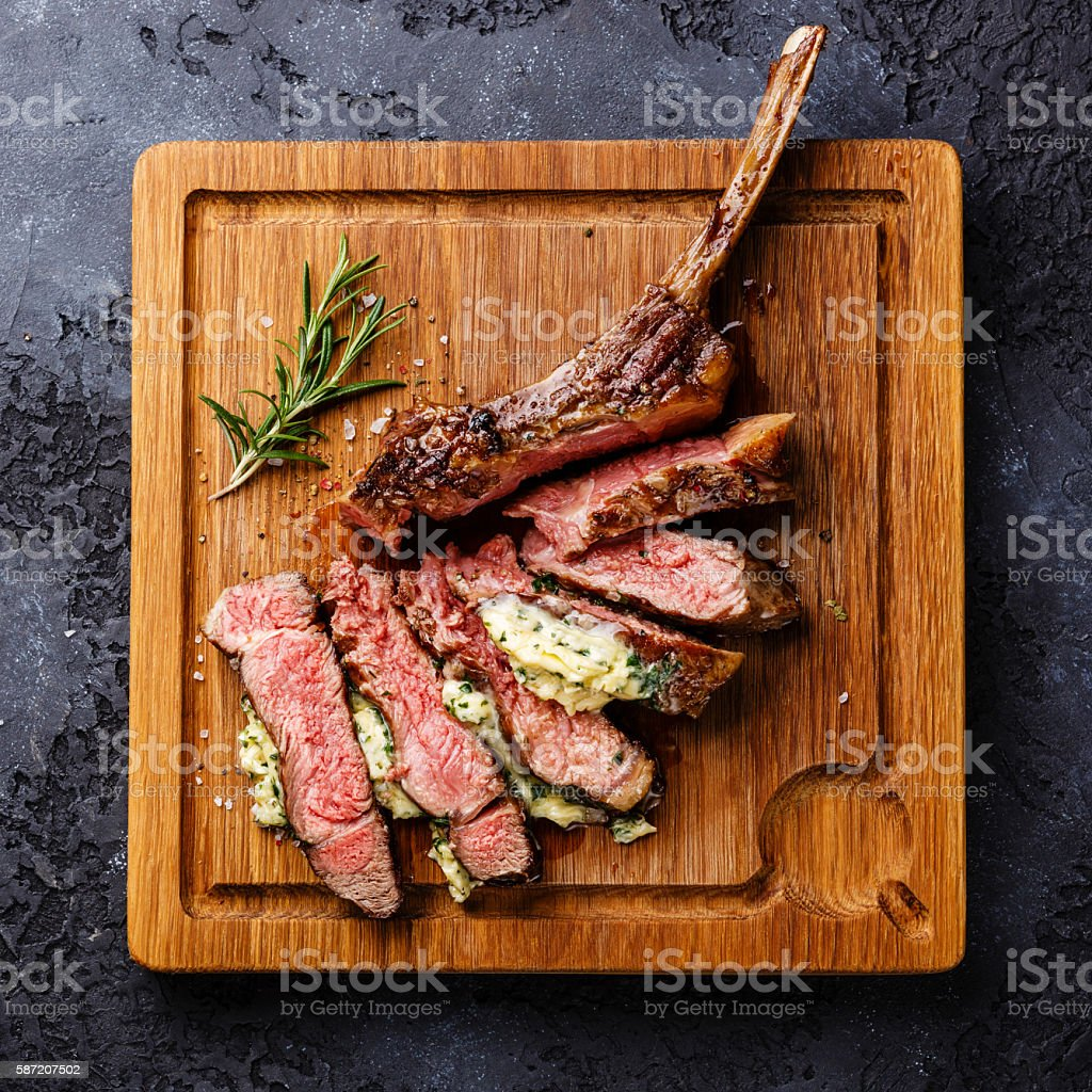 Sliced grilled Veal rib with herb butter stock photo