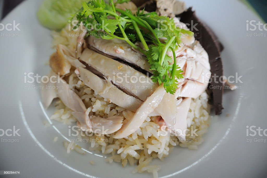 sliced Hainan-style chicken with marinated rice stock photo