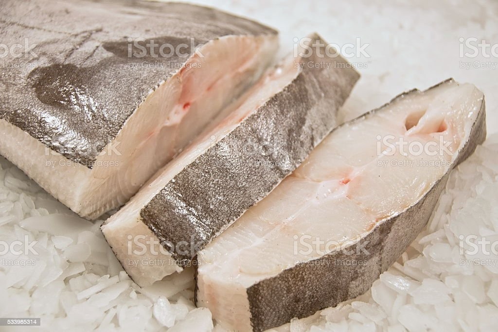 Sliced Halibut fish on ice. stock photo