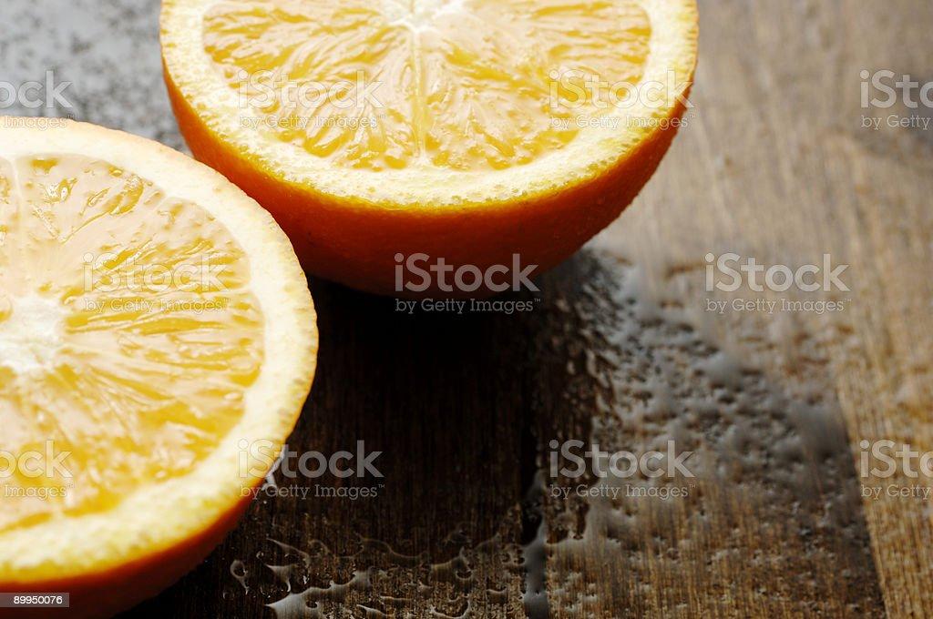 sliced halved wet juicy oranges stock photo