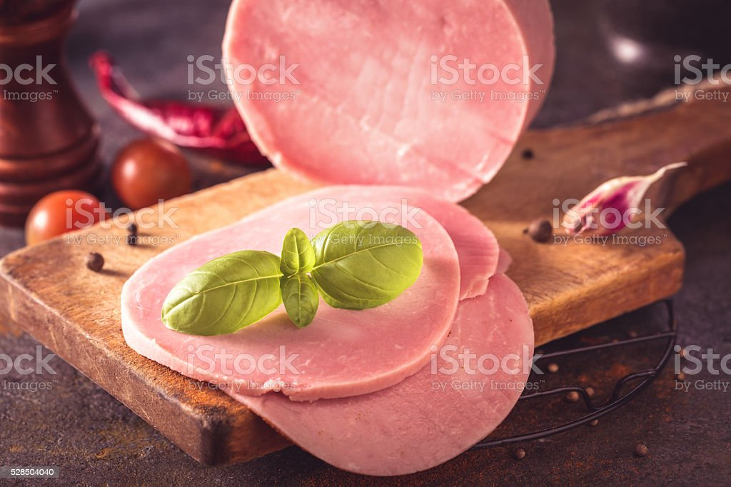 Sliced ham on cutting board stock photo