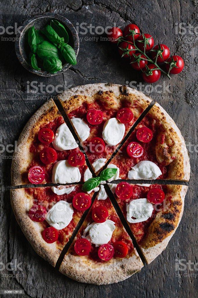 Sliced handmade pizza stock photo
