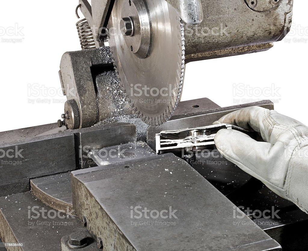sliced hard drive on circular saw stock photo